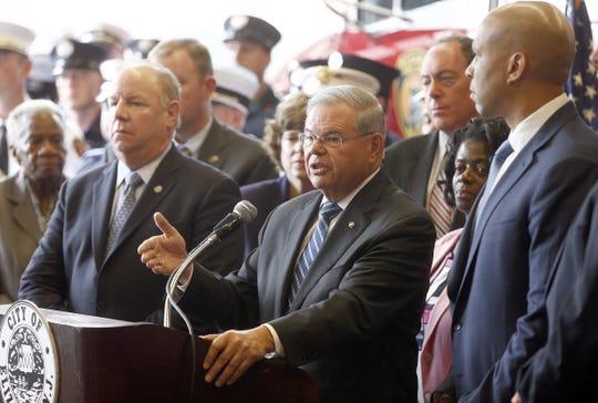 US Senator Robert Menendez (center, D-NJ) is joined by Elizabeth, NJ, Mayor J. Christian Bollwage (left) and fellow US Senator Cory Booker speaking Monday afternoon, September 19, 2016, about the arrest of bombing suspect Ahmad Khan Rahami during a news conference in Elizabeth, NJ.