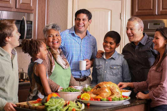 Diverse Family In Home Kitchen Cooking Thanksgiving Dinner