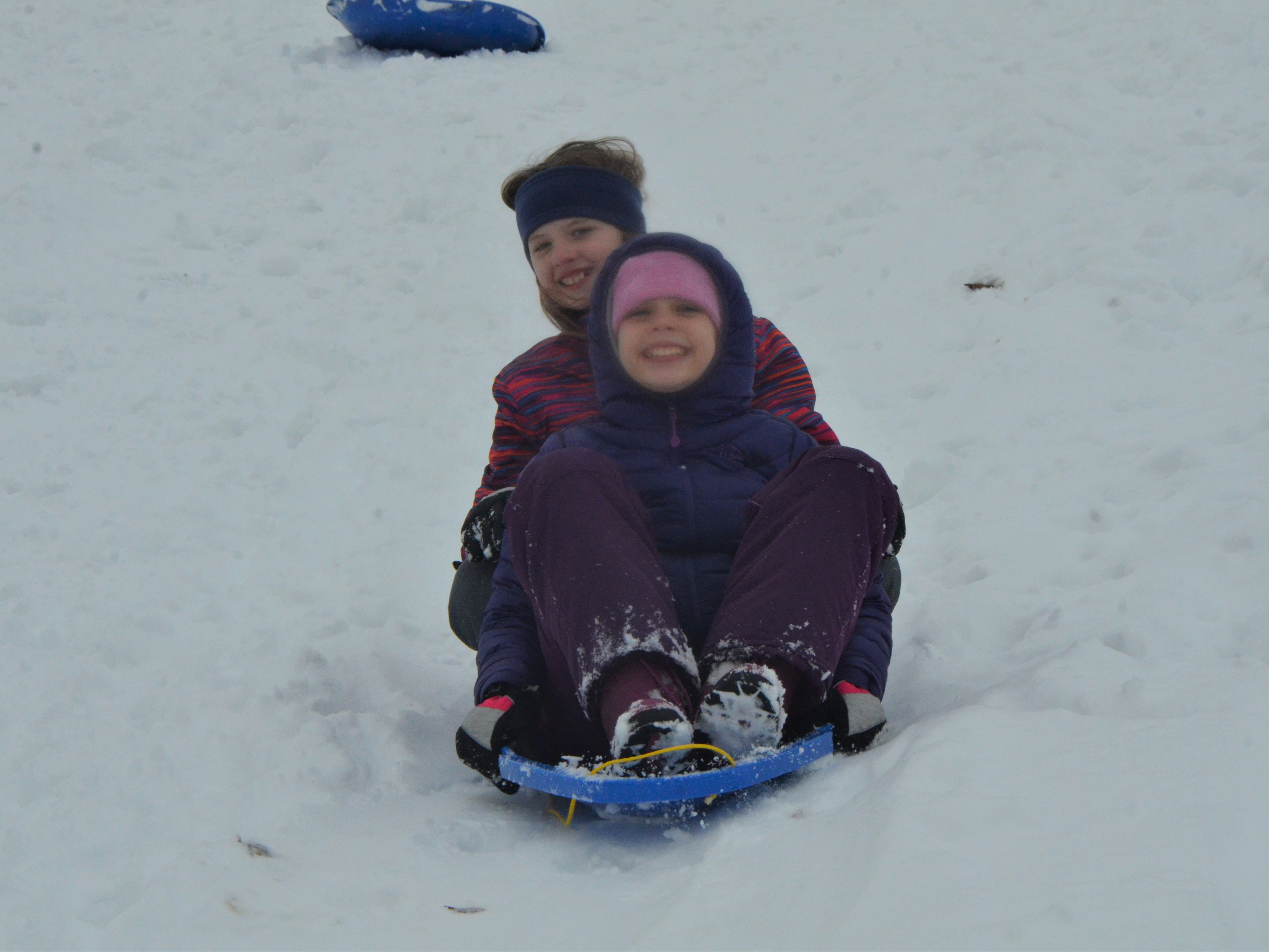 Sisters Alexandria Camburn and Evey Camburn sled down a hill together at Leila Arboretum on Monday, November 26, 2018.
