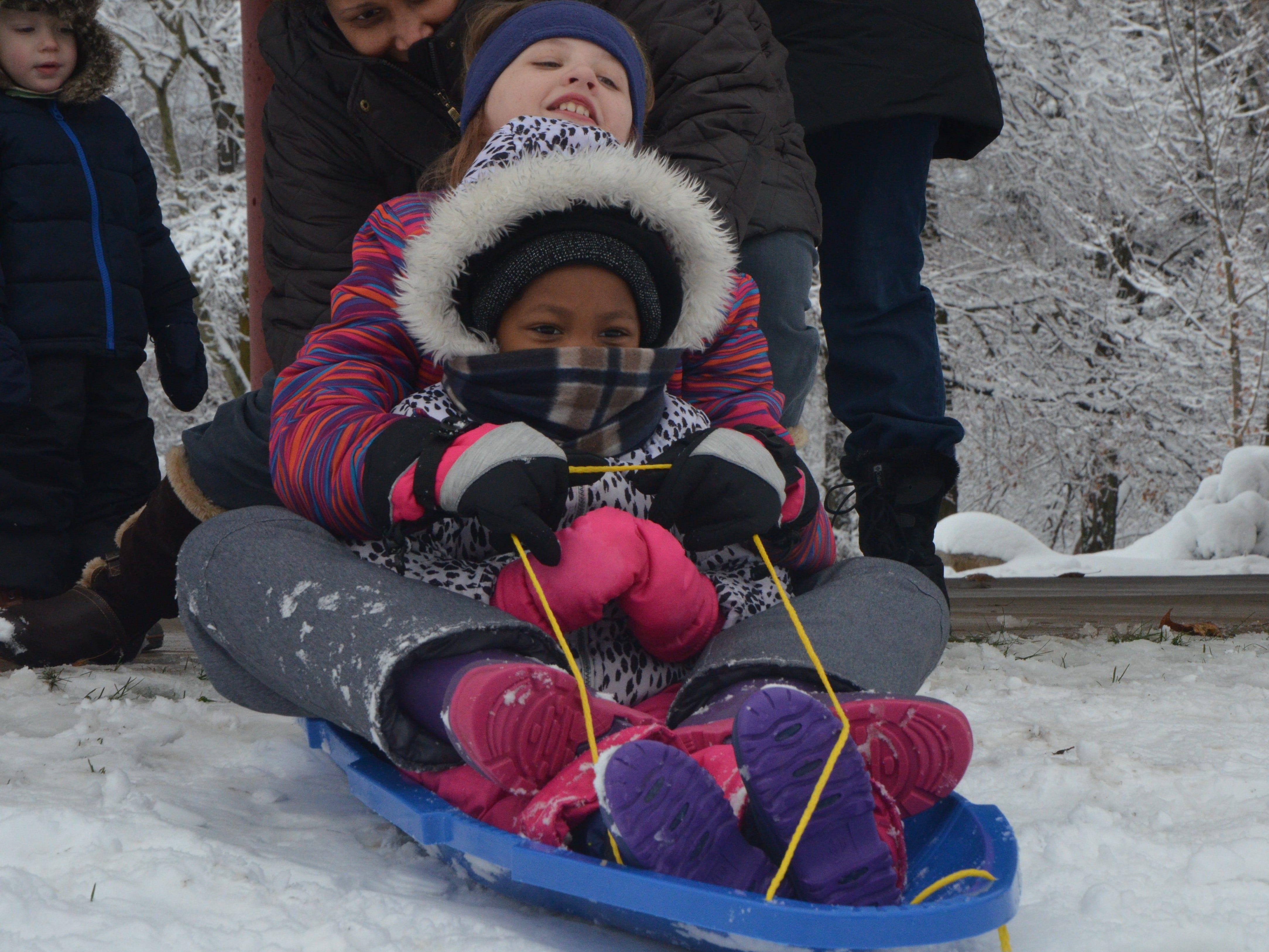 Caron Camburn pushes Alexandria Camburn, 11, and Nadia Craft, 4, down the hill at Leila Arboretum on Monday, November 26, 2018.