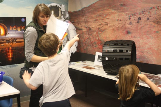 Lima resident Leander Apostoleris, 7, points out locations of Mars to his mother, Cathy Apostoleris.