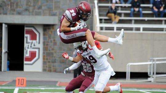 Colgate safety Alec Wisniewski goes airborne to defend.