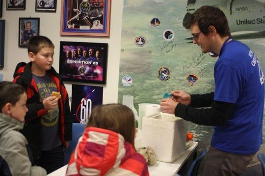 Jeremy Cartie gives a carbon dioxide demonstration at the Kopernik Observatory & Science Center Monday afternoon.