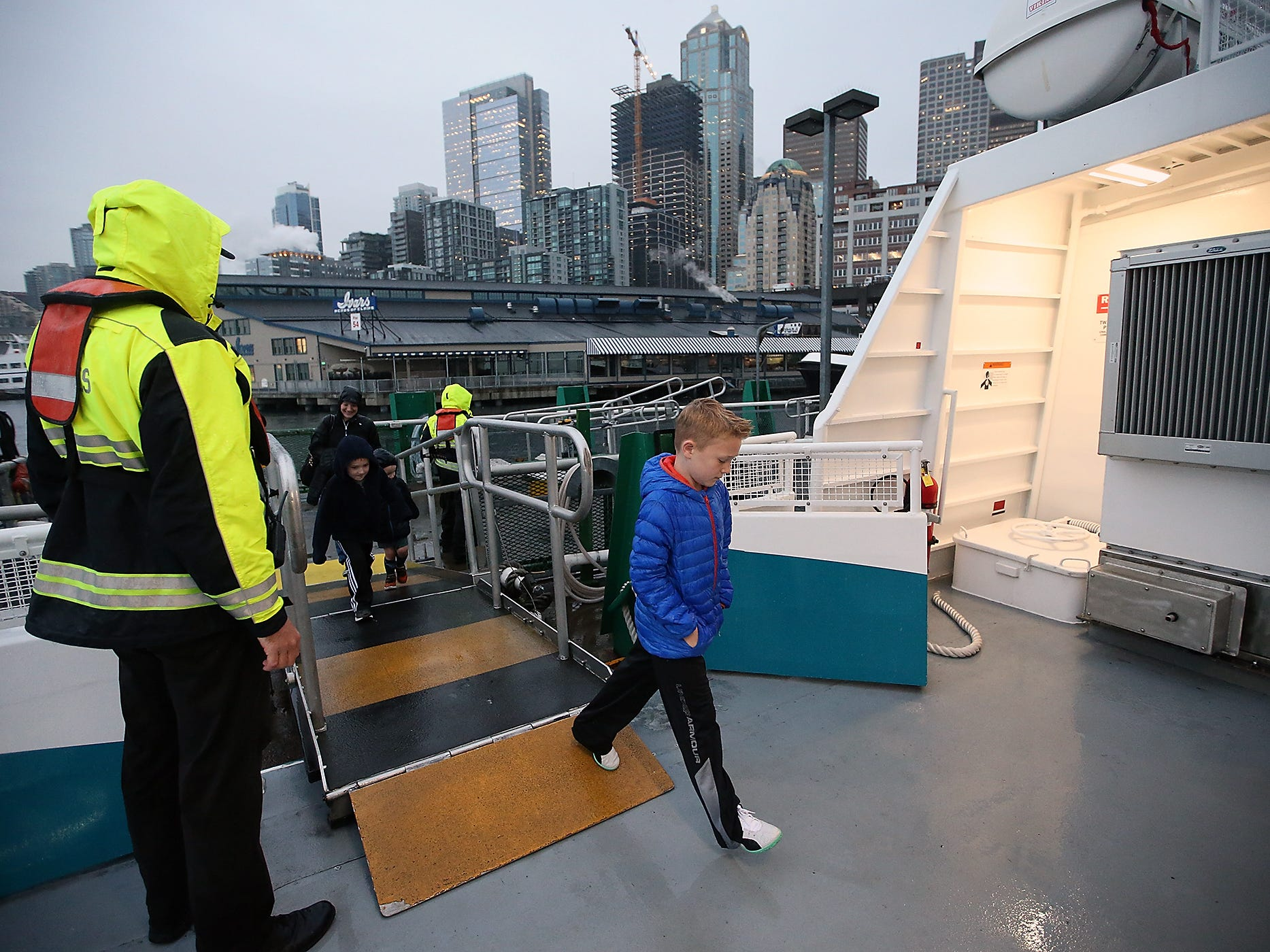 Patrick Sainsbury, 8, boards the M/V Finest at the dock in Seattle as he and his family head to Kingston to visit his grandparents on Monday, November 26, 2018.