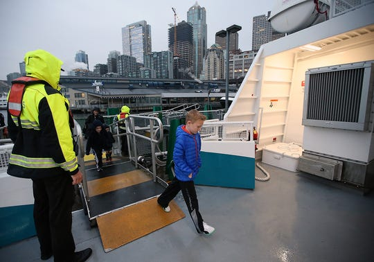 Patrick Sainsbury, 8, boards the MV Finest in Seattle on Monday.