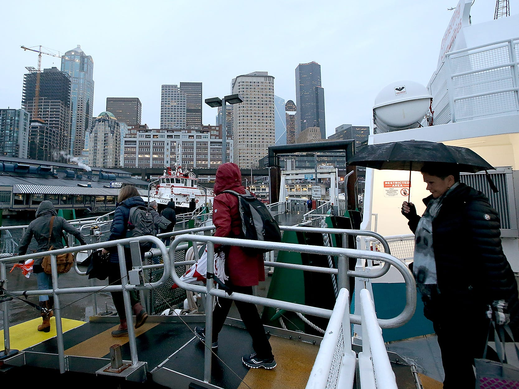 Passengers disembark the M/V Finest in Seattle after taking the 7:05 boat from Kingston on Monday, November 26, 2018.