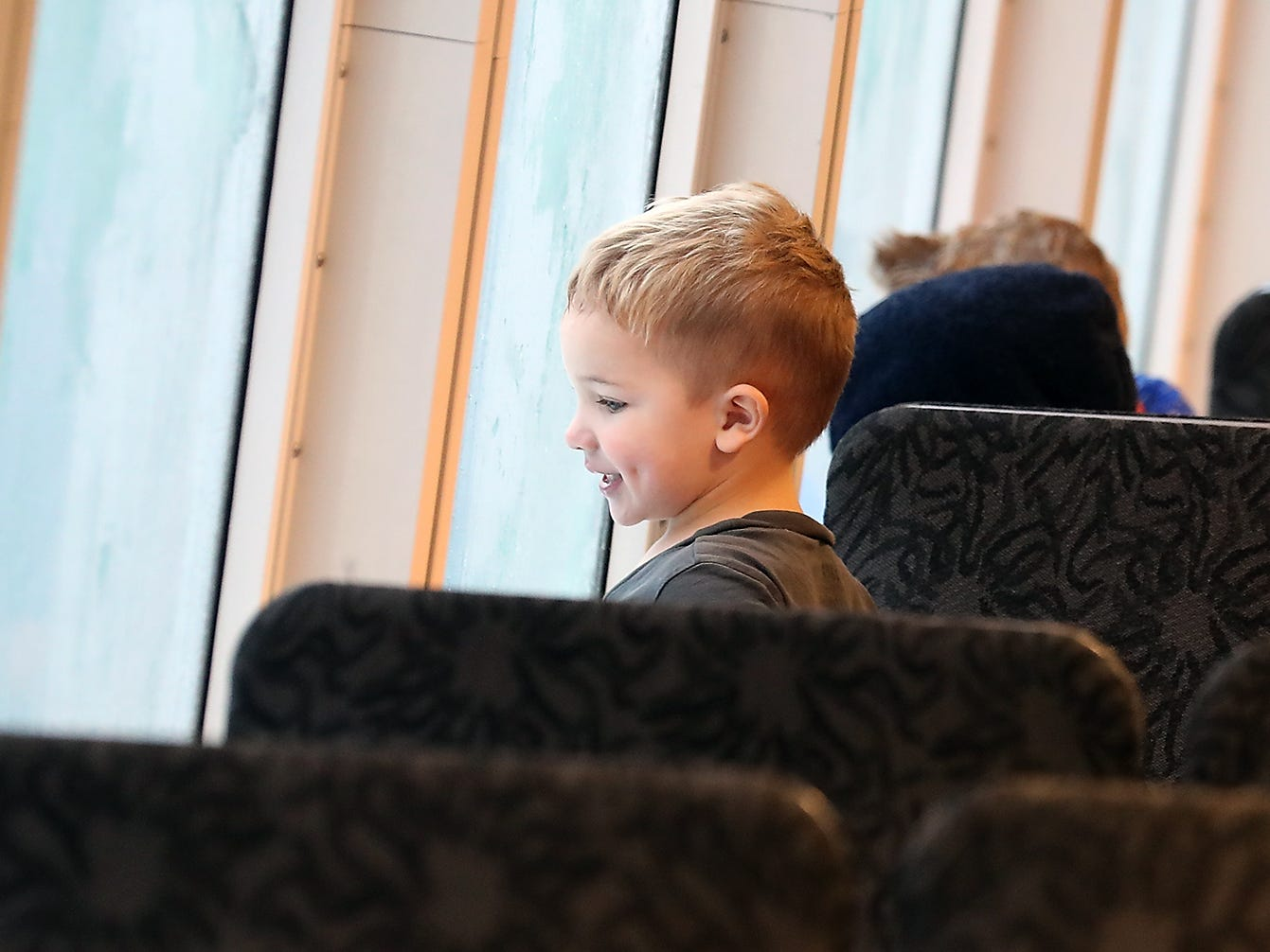 Jamie Sainsbury, 3, looks out the cabin window while riding the M/V Finest from Seattle to Kingston with his mother and brothers on Monday, November 26, 2018.
