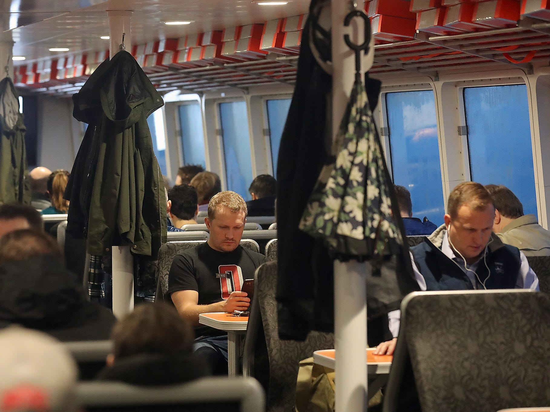 Peter Brown-Hayes looks at his phone while riding the M/V Finest from Kingston to Seattle on Monday, November 26, 2018.