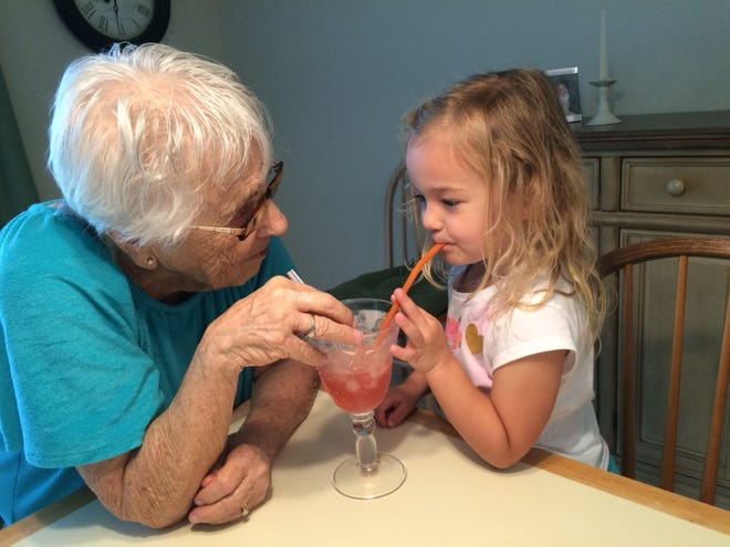 Isabella enjoys sharing a drink with her great-grandmother, Ann Maimone.