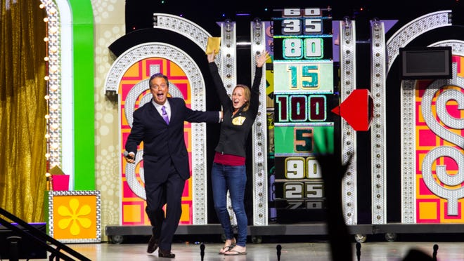 The Price is Right Live! host Todd Newton celebrated with a winning contestant. The live show comes to the Milwaukee in November.