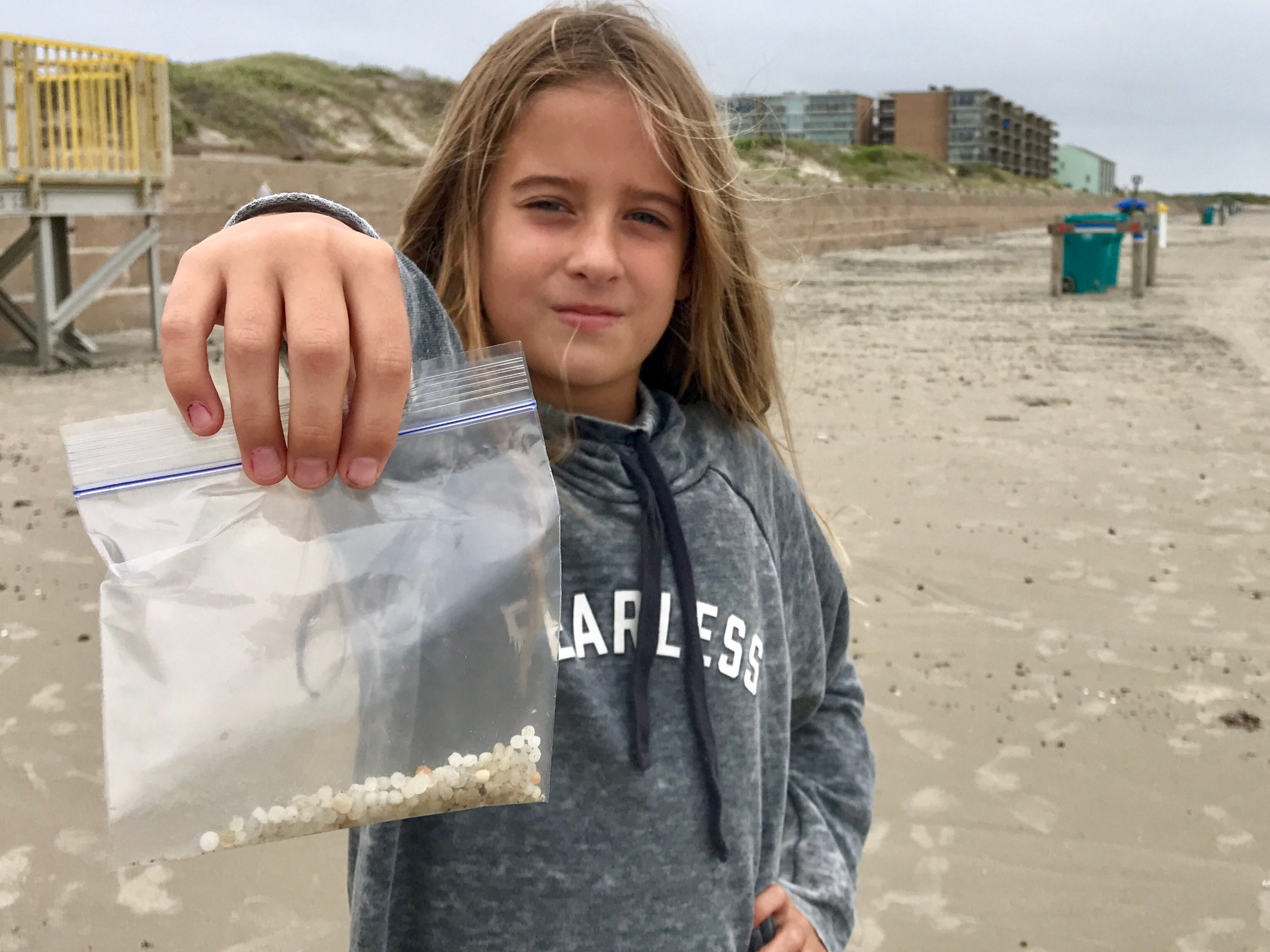 Parker Tunnell, 9, is collecting nurdles as part of a school science project.