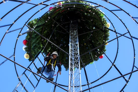 Joe Henry, with FSG Electric, installs sections of the new H-E-B Christmas Tree at the Water's Edge Park on Monday, November 26, 2018. The tree features more than 7,000 lights, 2,000 ornaments and a nativity star and is 66-feet tall. It costs about $250,000 and is sponsored by H-E-B. The tree will be the centerpiece for the Harbor Light's festival which is Saturday.