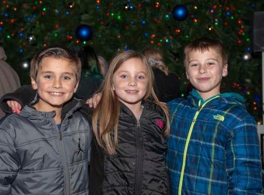 The 10th Annual Light Up the Levee Celebration kicked off Sunday, Nov. 25, 2018. Shown here, from left, are Cooper Willhite, Charlotte Willhite and Lucas Rains.