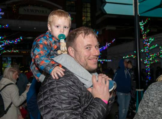 The 10th Annual Light Up the Levee Celebration kicked off Sunday, Nov. 25, 2018. Matt Rains of Milford with 3-year-old Maxwell on his shoulders.