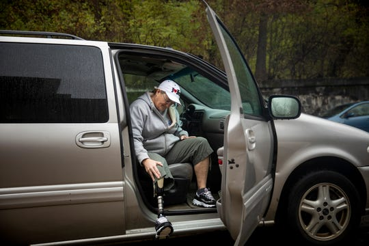 Kim Yocum gets into her van outside the Santa Maria Community Services building in Lower Price Hill on Nov. 26, 2018. Multiple blood clots due to coronary pulmonary artery diseases in her right leg resulted in her losing her leg three years ago. Her amputation makes her ability to complete daily activities challenging.