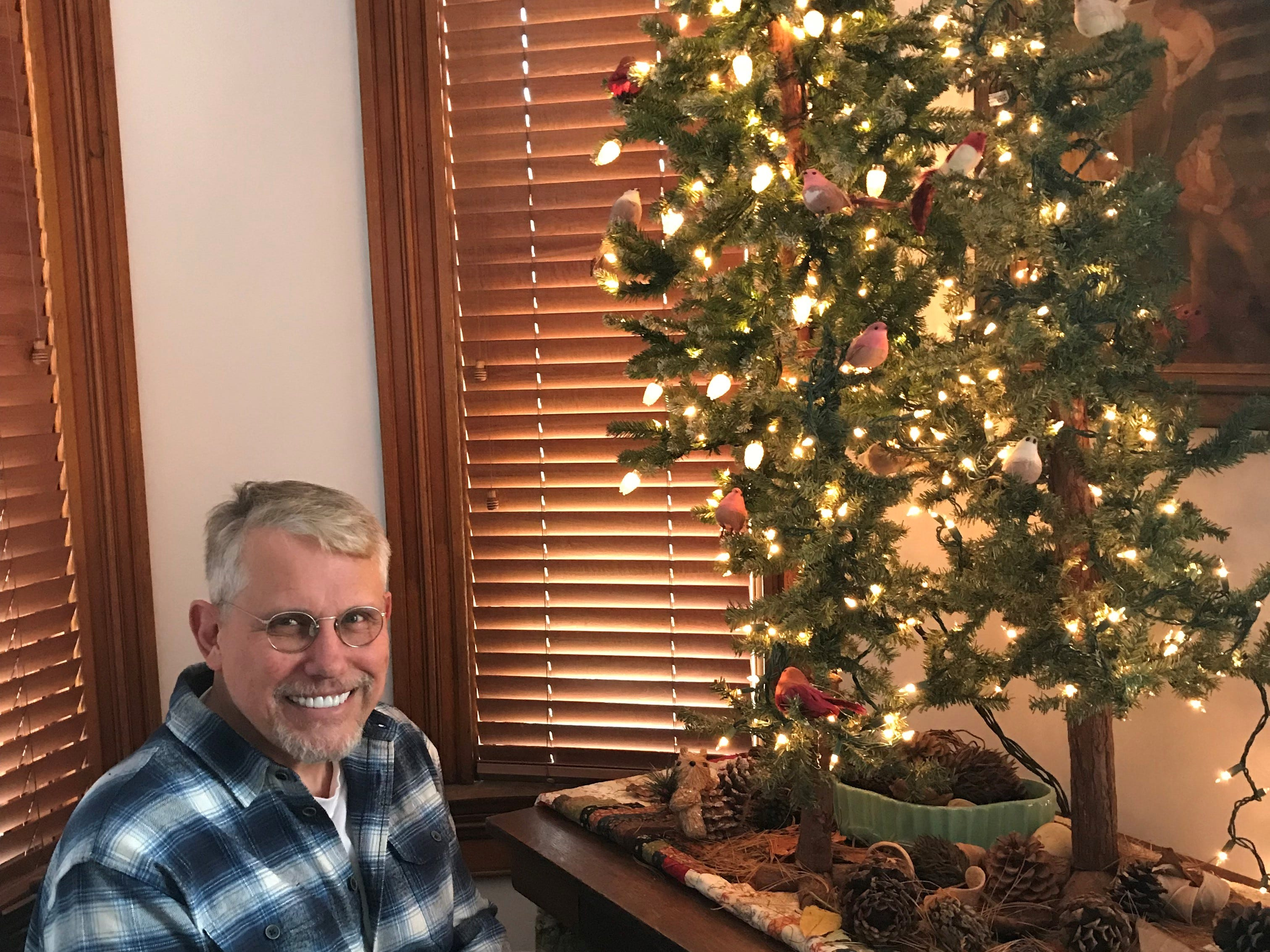 Jim Price sits in a corner of his house at 301 Overton St. It will be on the East Row Victorian Christmas tour, Nov. 25, 2018.