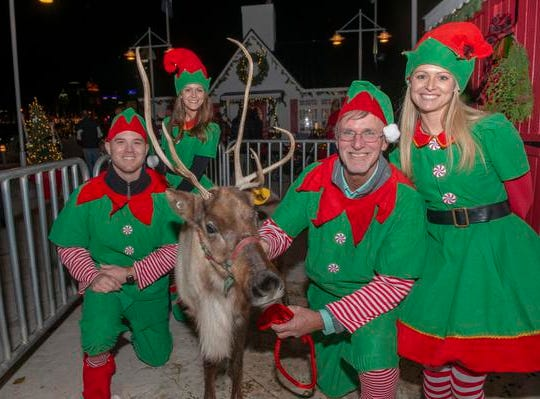 The 10th Annual Light Up the Levee Celebration kicked off Sunday Nov. 25, 2018. Santa elfs and one of his reindeer.