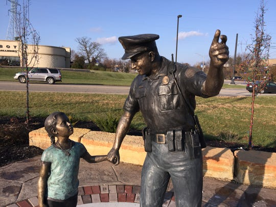 A statue honoring the Florence Police Department is one of three at the new Florence Community Plaza at 8001 Mall Road. The city's tree lighting ceremony will take place there.