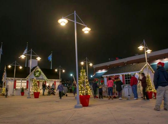 The 10th Annual Light Up the Levee Celebration kicked off Sunday, Nov. 25, 2018. Santa's new house and village at Newport Levee.