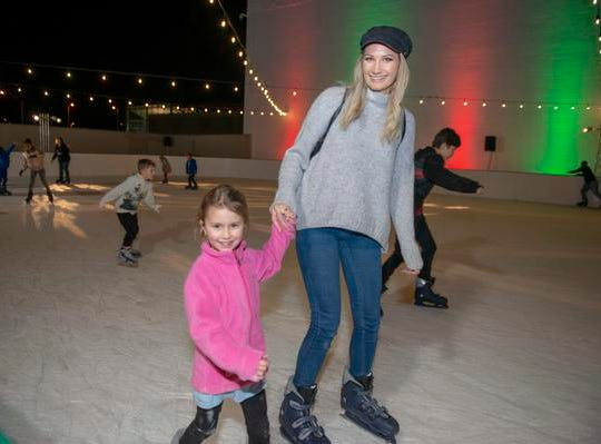 The 10th Annual Light Up the Levee Celebration kicked off Sunday, Nov. 25, 2018. Kate Sowder of Ludlow with her daughter Mila enjoy laps on the ice.