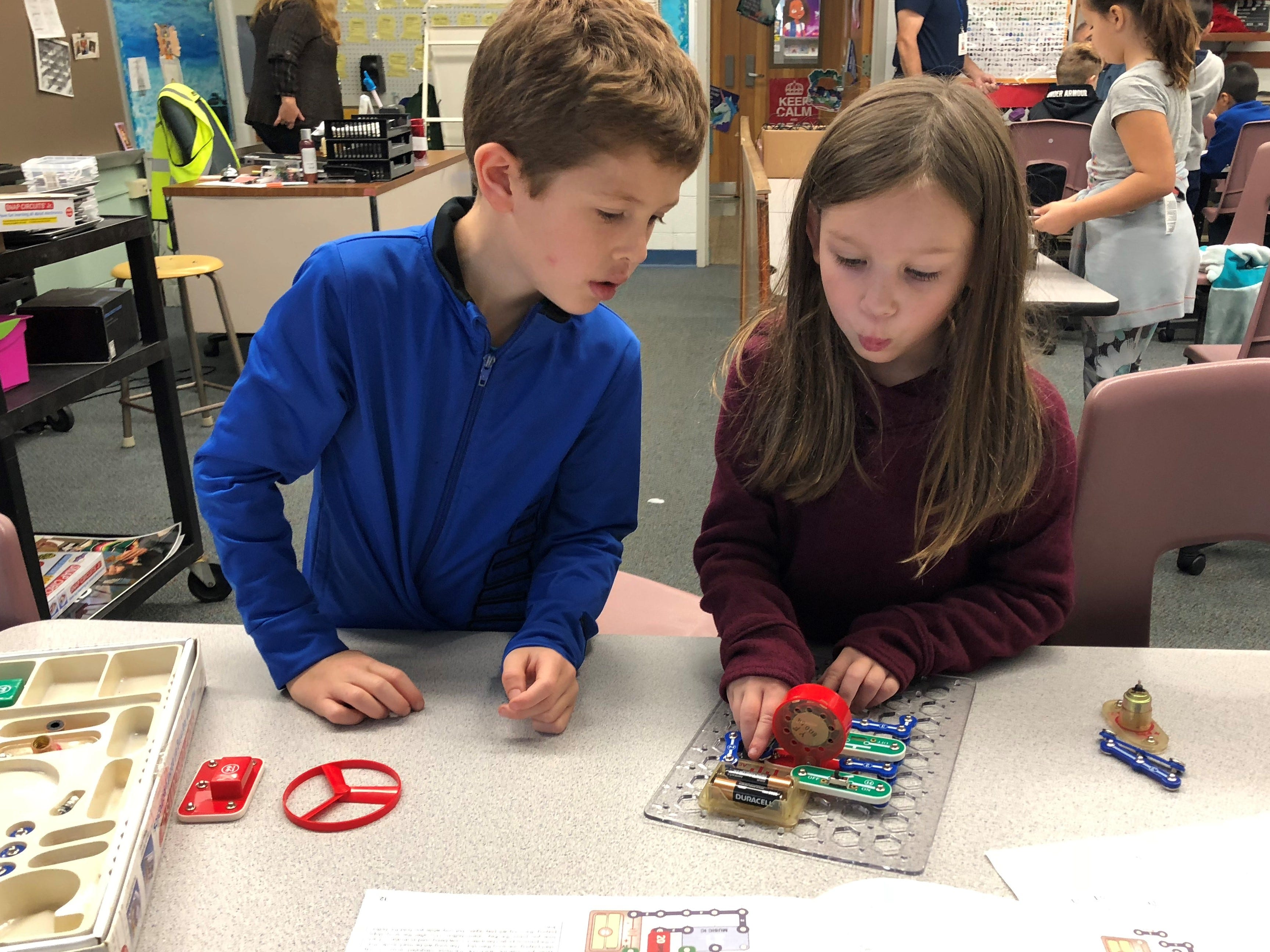 Ryan Feeney, grade 1 student and Claire Connolly, grade 1 student exploring their circuit kits during iBuilders Club.