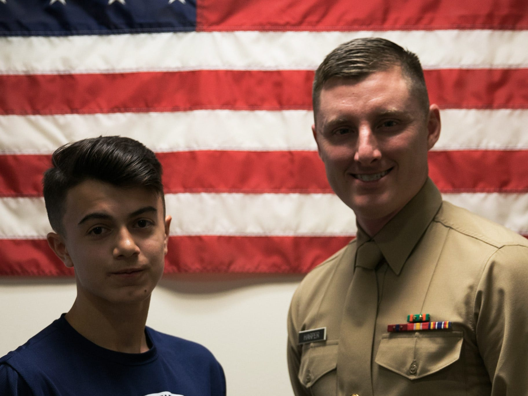 Joseph Campione as a 2018 Semper Fidelis All-American with Staff Sgt. Kenneth Harper, local recruiter for the Somerset area. He attended the Battles Won Academy this past July in Washington, D.C., a prestigious honor afforded to 99 students across America.