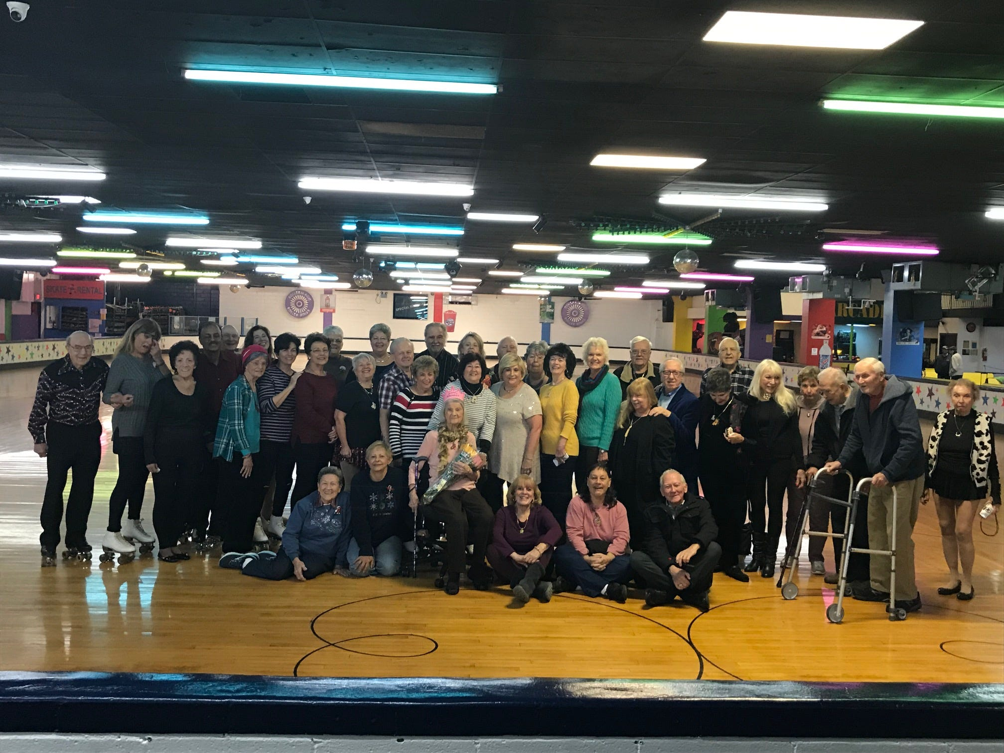 Carrie Callandrullo (center) celebrated her 100th birthday Nov. 14 with her friends at the skating rink.At least twice a week, more than 20 seniors regularly gather at South Amboy Arenaand take to the rink for a couple hours of roller skating. They range in age from 55 to 100.