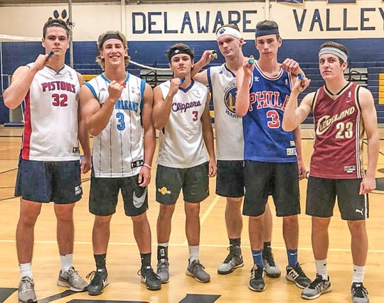 While not exactly Super Bowl bling, these candy rings were won by the top Volley for Life team at Del Val High School. These players are, from left, Joe Cansfield, John Raymond, Jack Willard, Jake Norgard, Quin Denvir and Nick DiBetta.