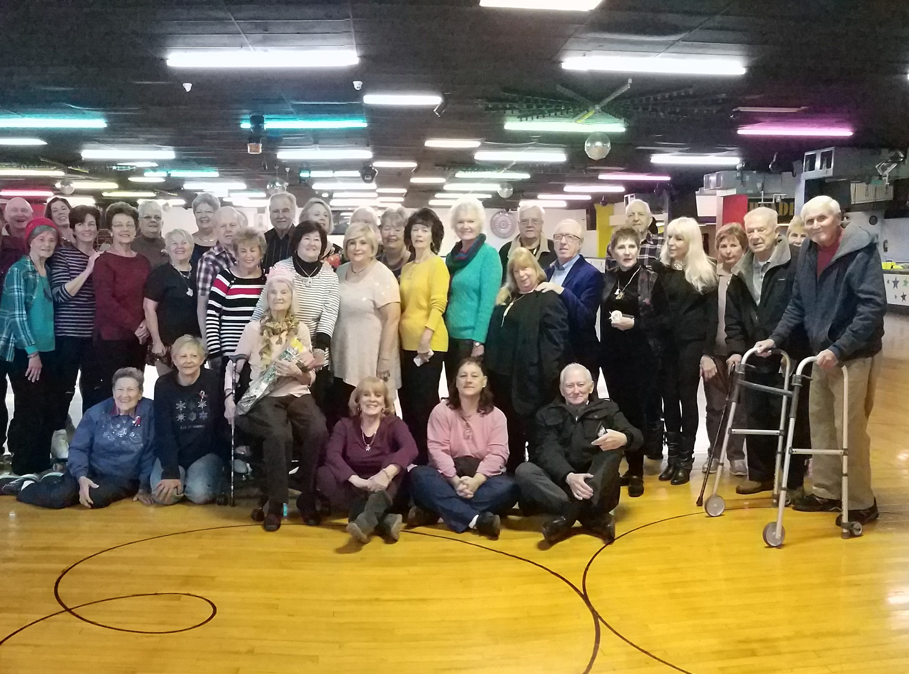 Carrie Callandrullo (center) celebrated her 100th birthday Nov. 14 with her friends at the skating rink. At least twice a week, more than 20 seniors regularly gather at South Amboy Arenaand take to the rink for a couple hours of roller skating. They range in age from 55 to 100.