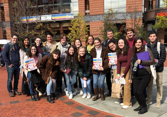 "WHS students and staff attend the Dodge Poetry Festival in Newark on Oct. 19, a celebration of eminent poets from the late 20th and early 21st centuries. ""My hope is to help students see that poetry is still an important, vital, and living art form and not one relegated to old texbooks,"" says English teacher David Della Fera."
