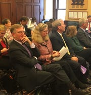 The presidents of Iowa's three state universities attended a budget hearing on Monday, Nov. 26, 2018, in Gov. Kim Reynolds' office. From left in the front row are: Mark Nook of the University of Northern Iowa; Wendy Wintersteen of Iowa State University; and Bruce Herreld of the University of Iowa.