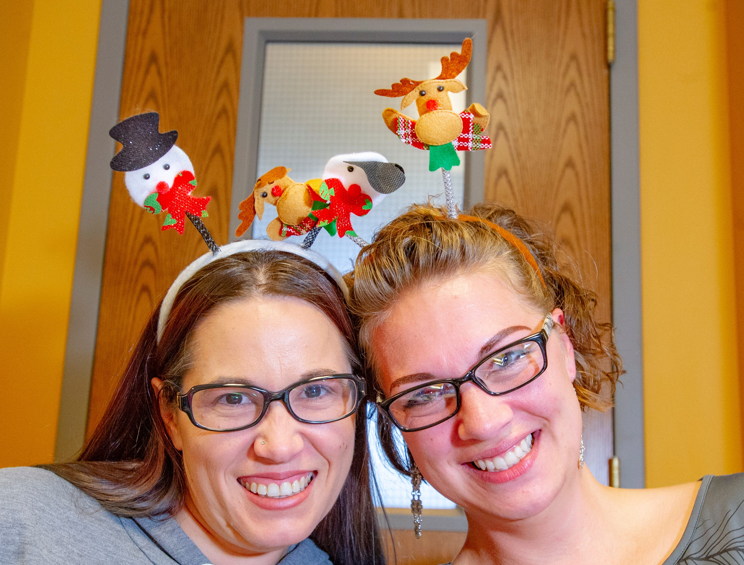 Sunshine Kluver, left, and Rachel Wilkening, of Norwalk, had fun at the Arts and Crafts Vendor Show held at the Warren County Administration Building Nov. 24, 2018. They had fun  representing their brand Level Health Products and wearing their Christmas headbands.