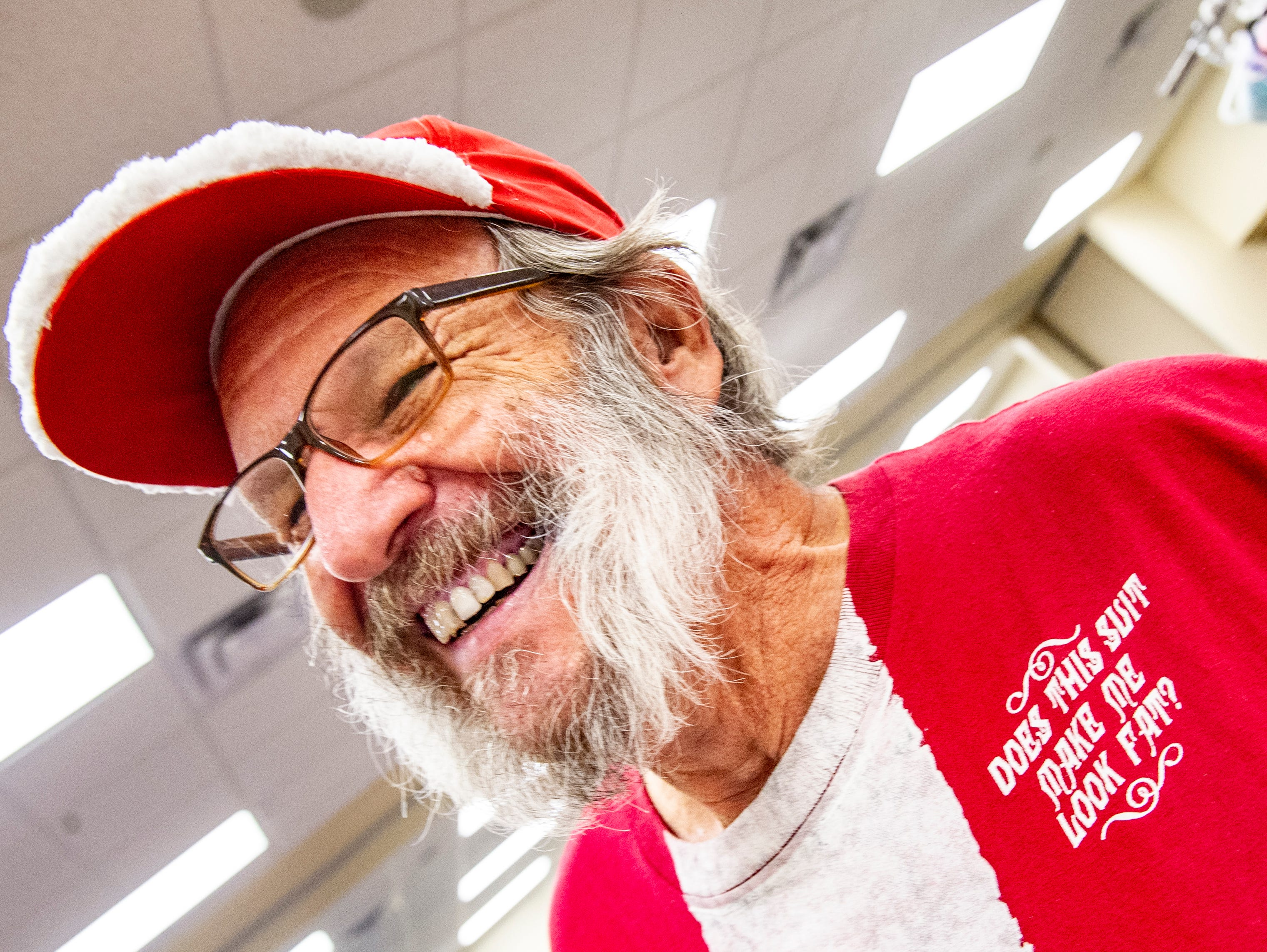 Jerry Ayers, of J and J Crafts, is as pleased with his Santa hat and T-shirt as he was with his craft items he had for sale at at the Rustiqueiowa Homespun Holiday Market held at the Trinity Presbyterian Church in Indianola Nov. 24, 2018.