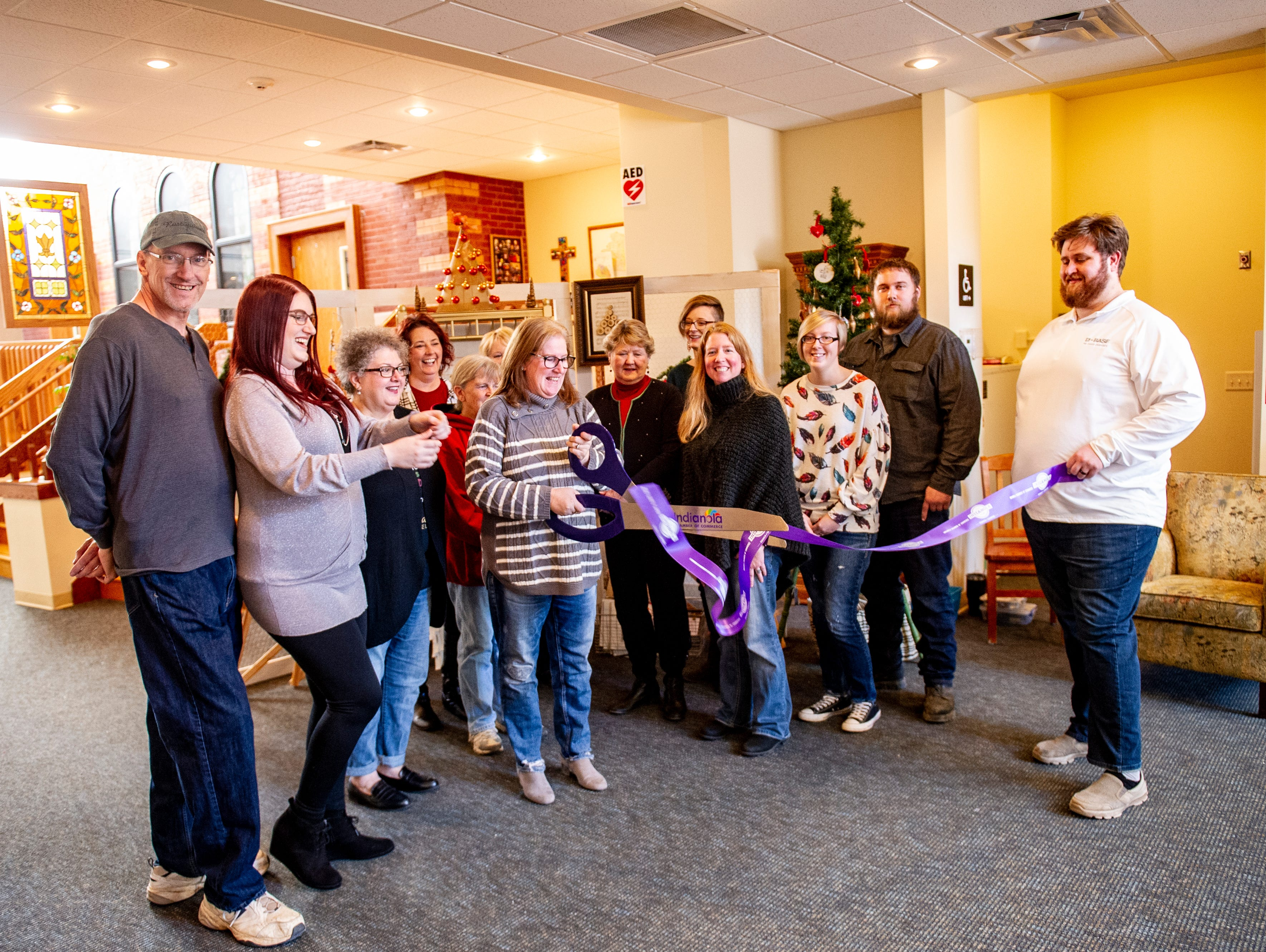 A ribbon-cutting was held for the Rustiqueiowa Homespun Holiday Market held at the Trinity Presbyterian Church in Indianola Nov. 24, 2018.