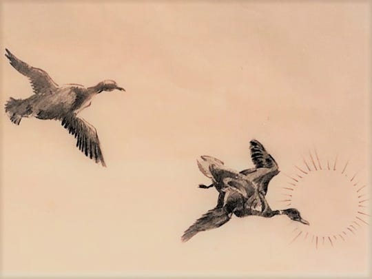 """Ky Phan Luong sketched the birds he saw while approaching the Malaysian shore during a scholarship at the Des Moines Art Center. Once presented to Gov. Robert Ray at the state Capitol, it now hangs in Luong's California home. This is close-up of the framed piece, """"Two Birds Flying for Freedom,"""" by Luong."""