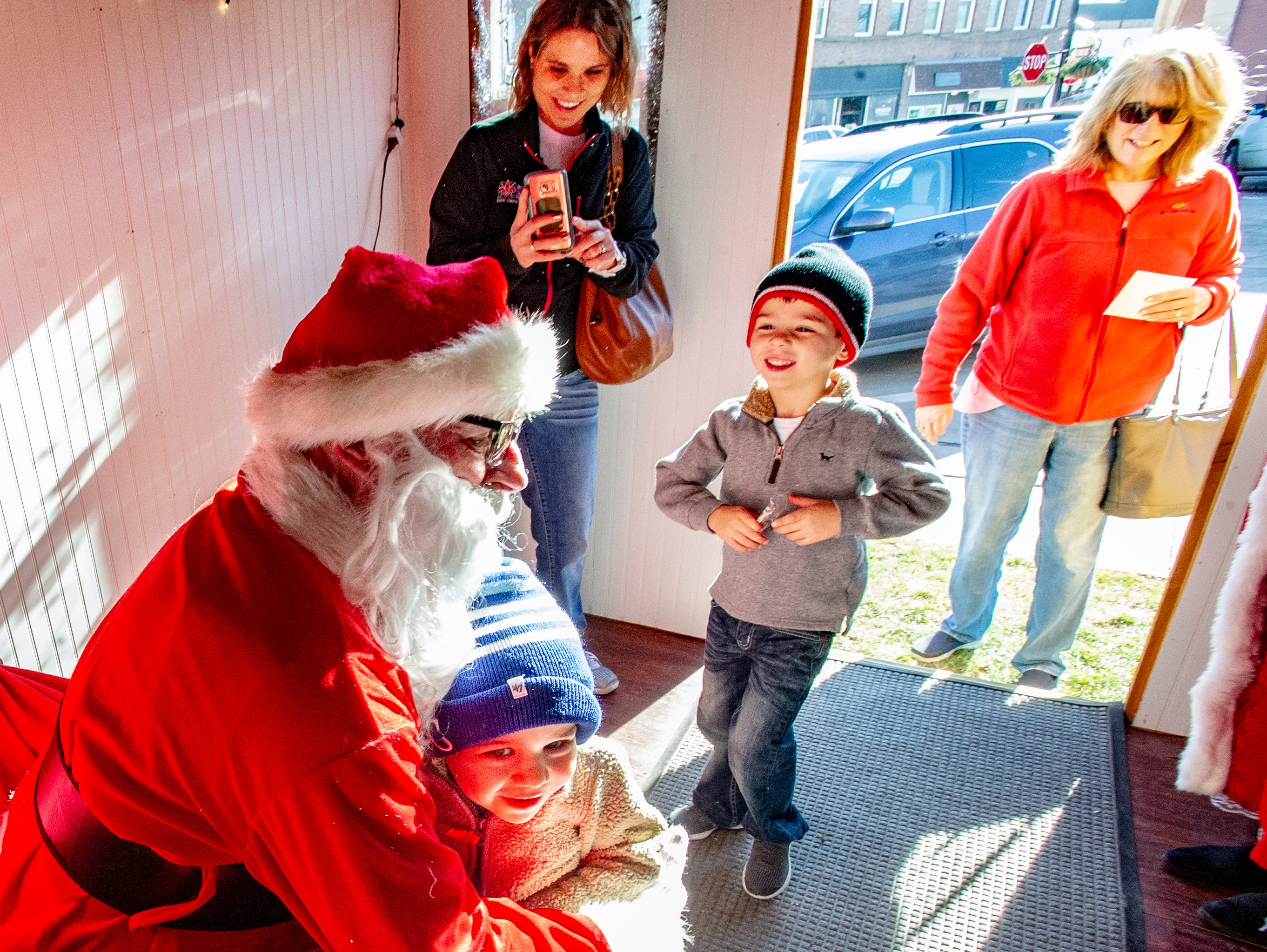Simon Ripley, 2, gets a hug from Santa after sharing his Christmas wish list. Jordan Ripley, 5, also received a hug while accompanied by their mother, Ashley Ripley and grandmother Julia Page, of Osceola. The group visited with Santa and Mrs. Claus at the Santa House in downtown Indianola Nov. 24, 2018.