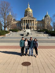 Ky Phan Luong, with his wife Hollie, son Mitchell and daughter Jacqeulyn, visited the Iowa Capitol during a four-day trip back to Des Moines over Thanksgiving. Luong first came to Des Moines as a refugee fleeing communist Vietnam in 1978.