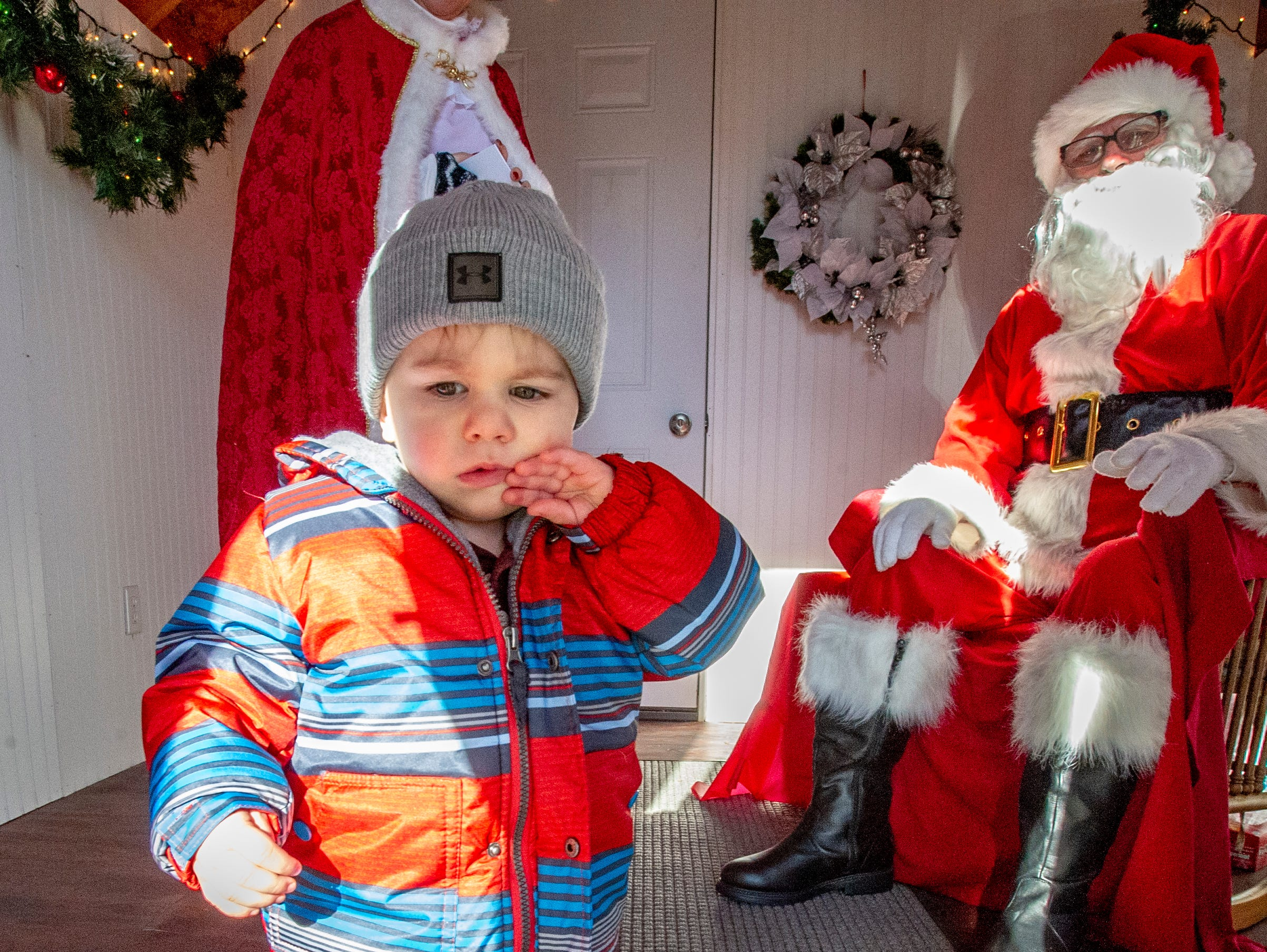 Killian Leach is not convinced he wants to meet Santa at the Santa House in downtown Indianola Nov. 24, 2018.