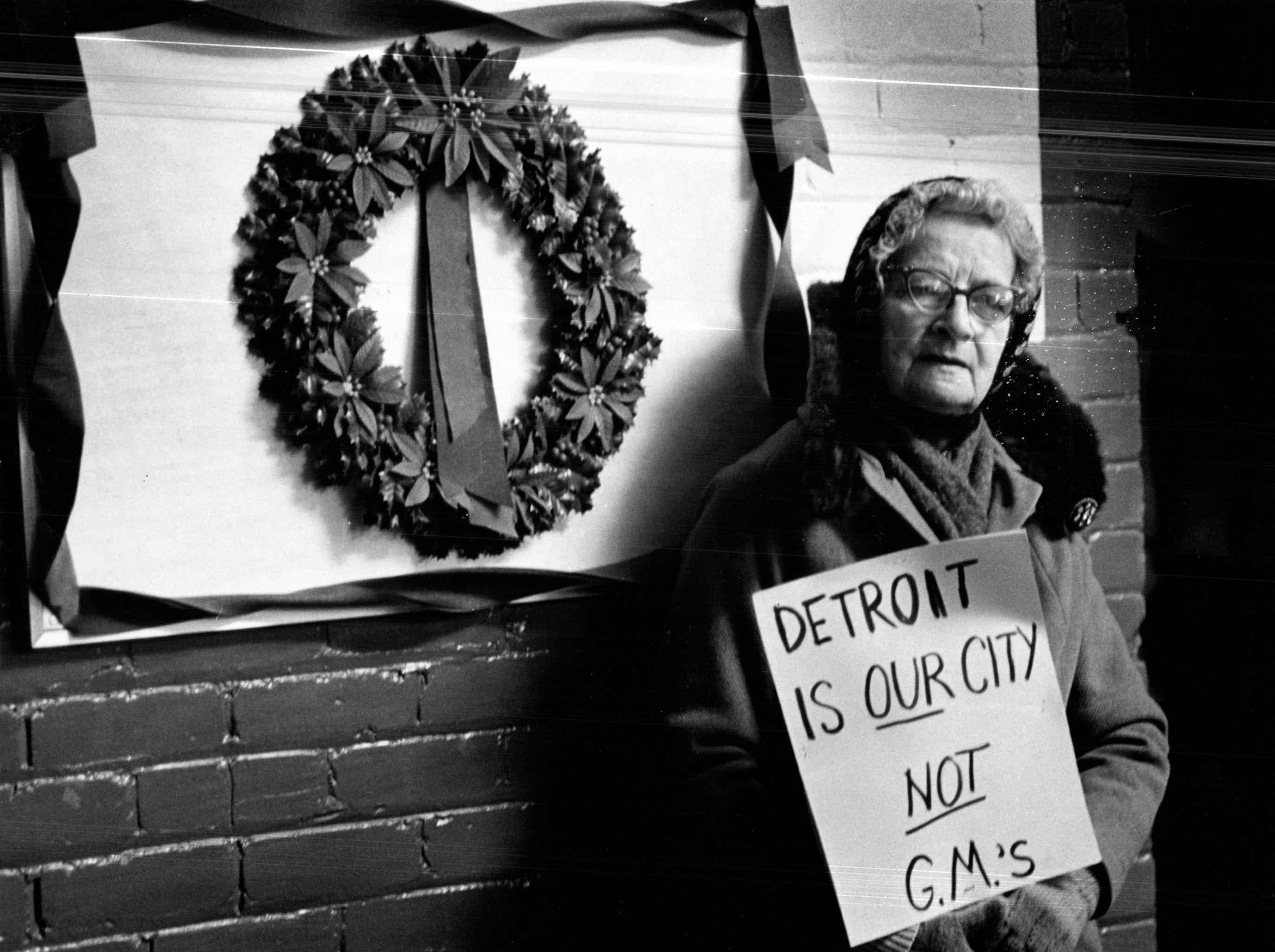 "Mary Poholsky, 73 and a 53-year resident of Poletown, joins neighbors in a 1980 protest. One protest sign read: ""The Soviet Union is ready to invade Poland, and GM is ready to invade us."""