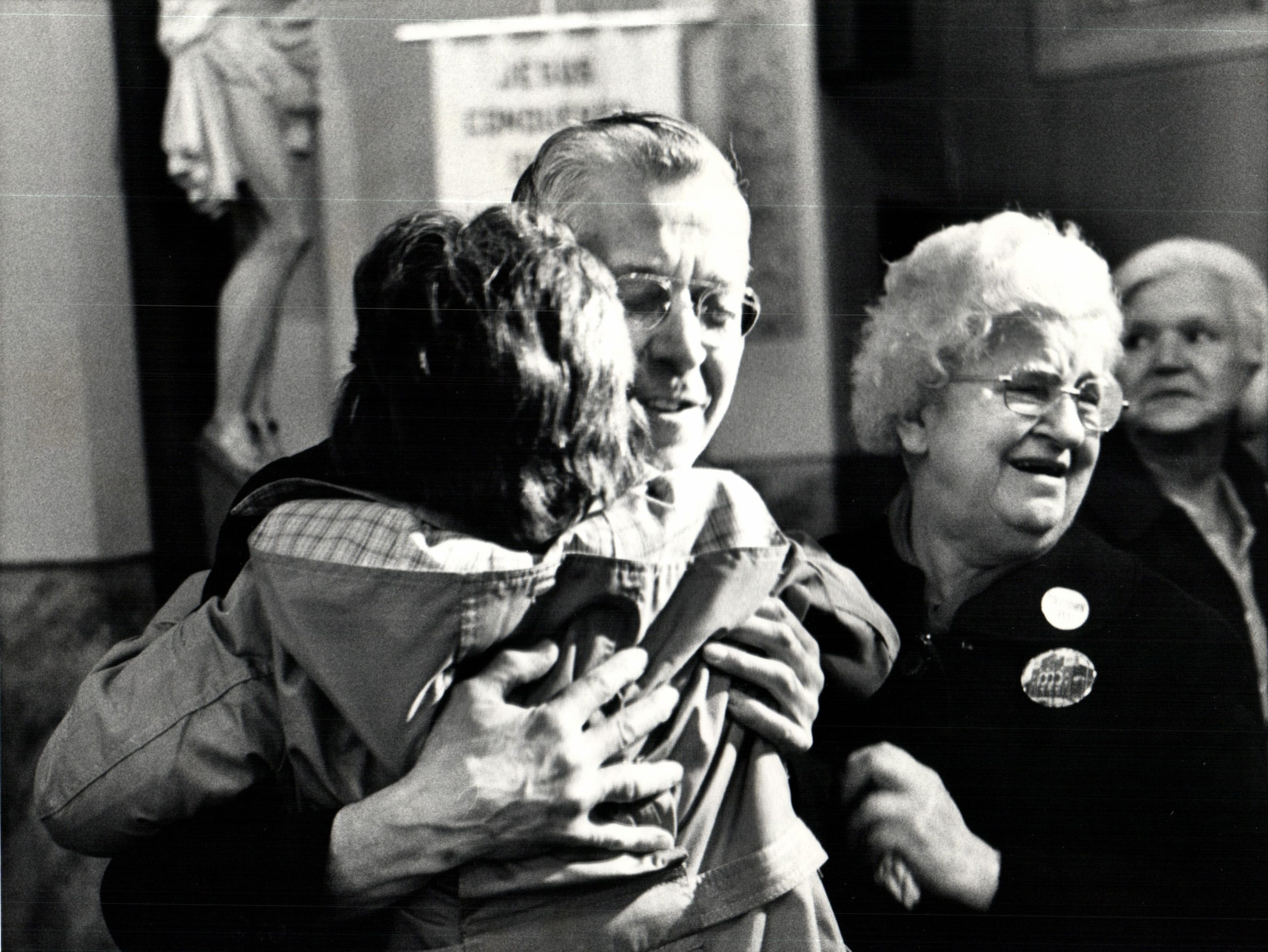 Father Joseph Karasievicz joyfully embraces a parishioner, Bernice Kaczynki, when news of the court decision reached the church. It ruled that the city of Detroit could not take over the church until June 17th. The church, in the Poletown neighborhood of Detroit, Michigan, sits on land that is being forcibly taken to build a General Motors plant. Second from right is Josephine Jakubowski.