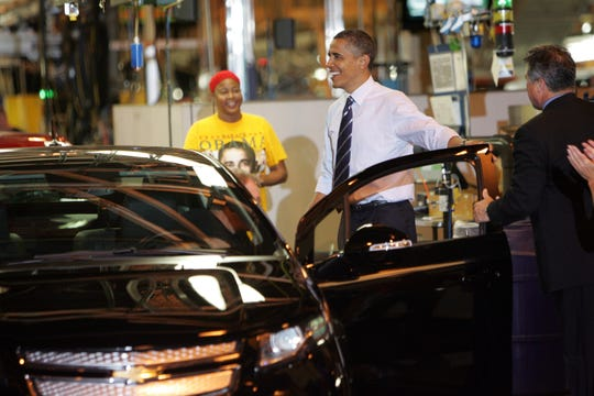 President Barack Obama prepares to drive a Chevrolet Volt at the Hamtramck GM plant during his visit to Detroit on Friday, July 30, 2010.