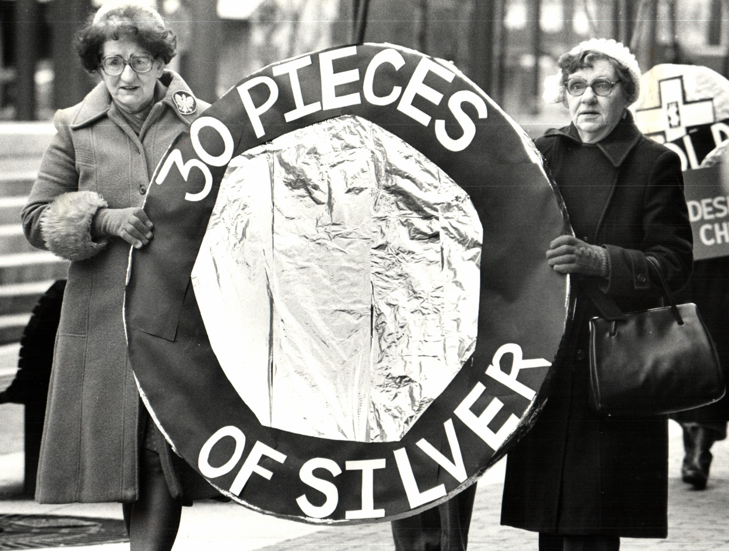 Long-time church members Barbara M. Sokol (left) and Ann Dolence march to protest the proposed demolition of the Church of the Immaculate Conception and the razing of the surrounding neighborhood of Poletown in order to build a new General Motors plant on the site.
