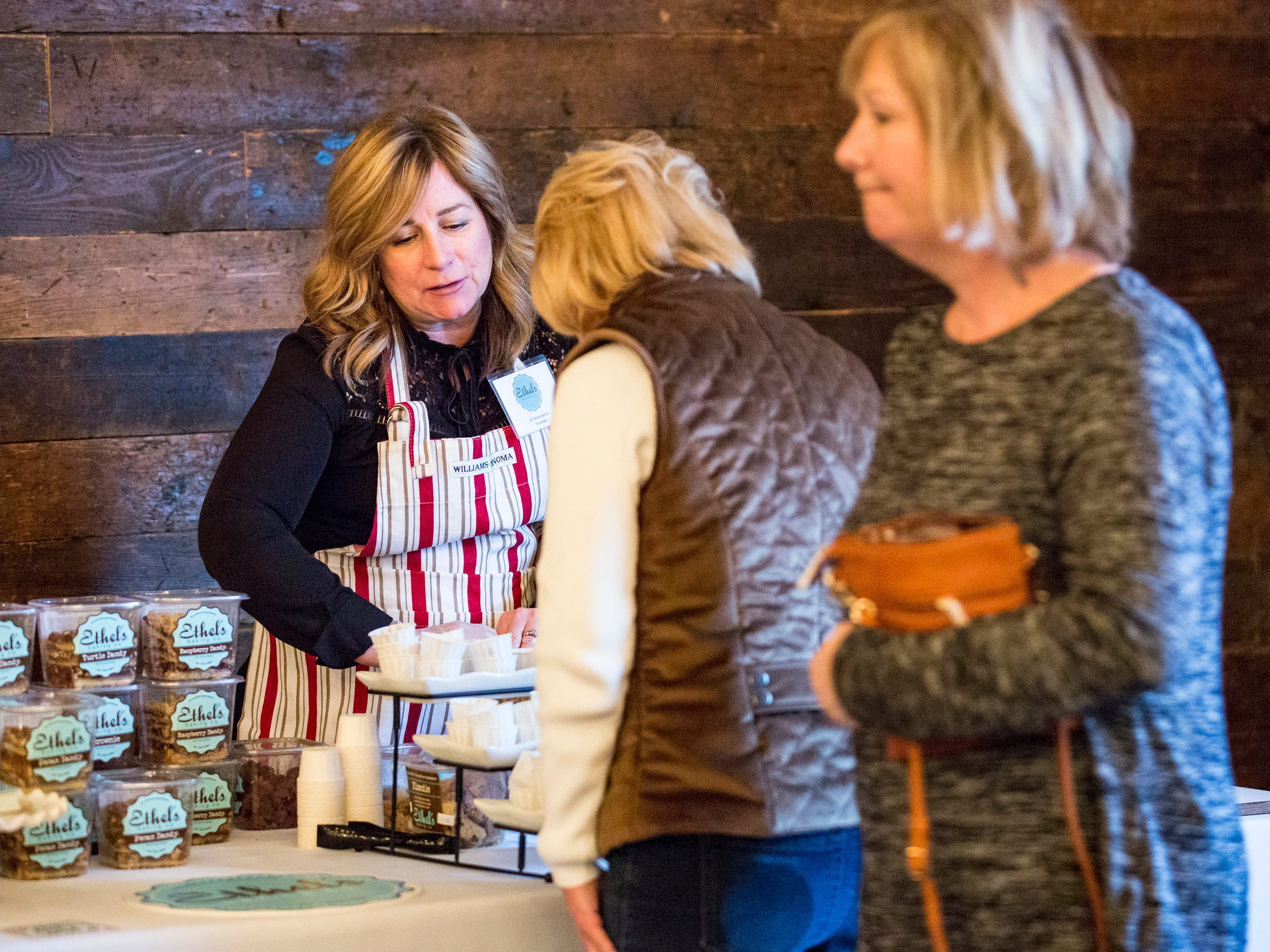 Jill Bommarito, founder of Ethel's Baking Co., chats with a guest during the Whisked event at the Great Lakes Culinary Center in Southfield, Mich., Sunday, Nov. 18, 2018.