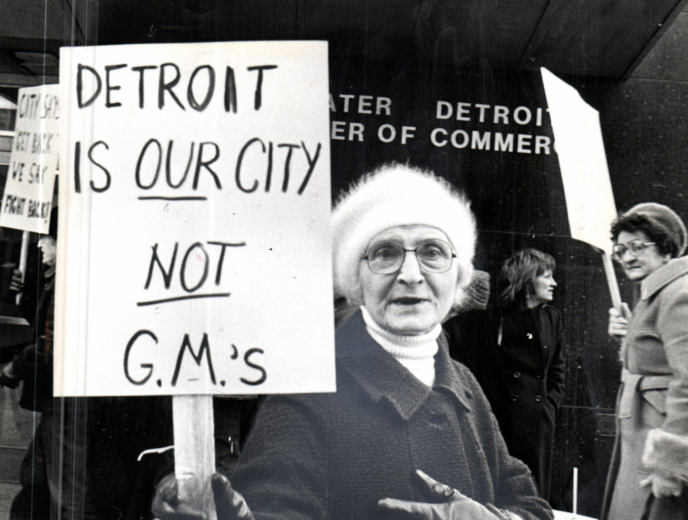 Pickets for the Poletown Neighborhood Council demonstrate against the plant at Detroit's Community and Economic Department office.