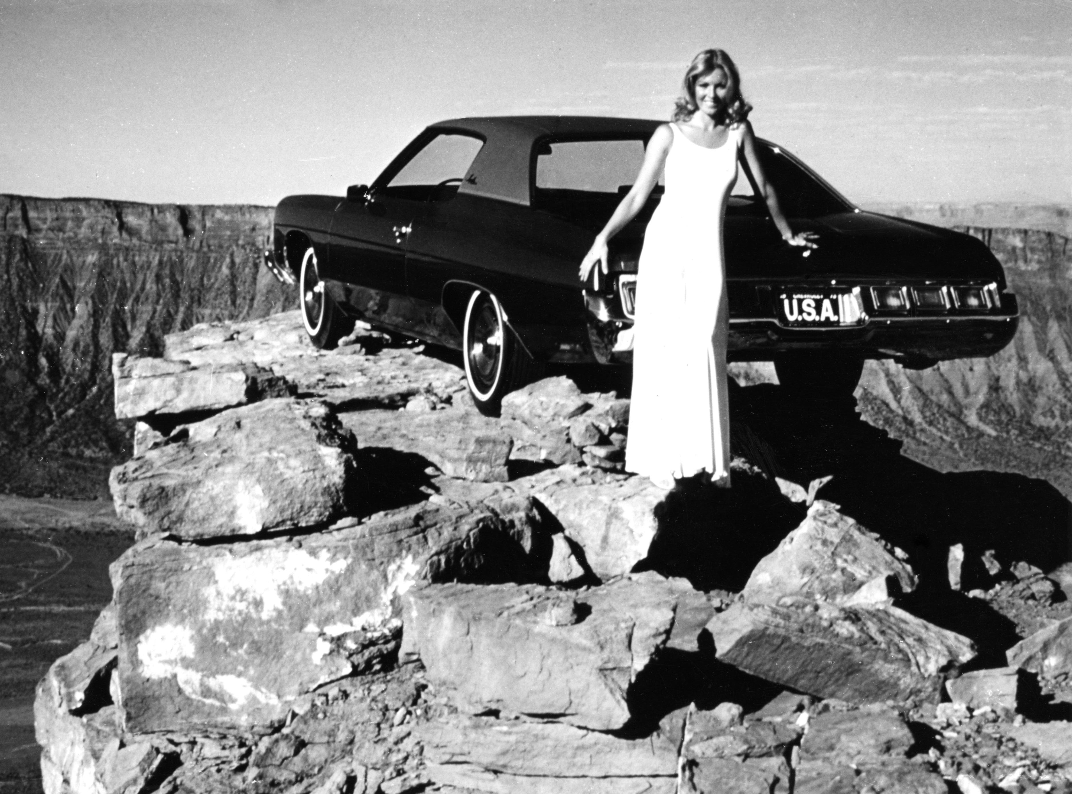 A commercial for the 1964 Impala put the car 1,500 feet in the air atop Castle Rock in Utah. This photo is from a 1972 recreation.