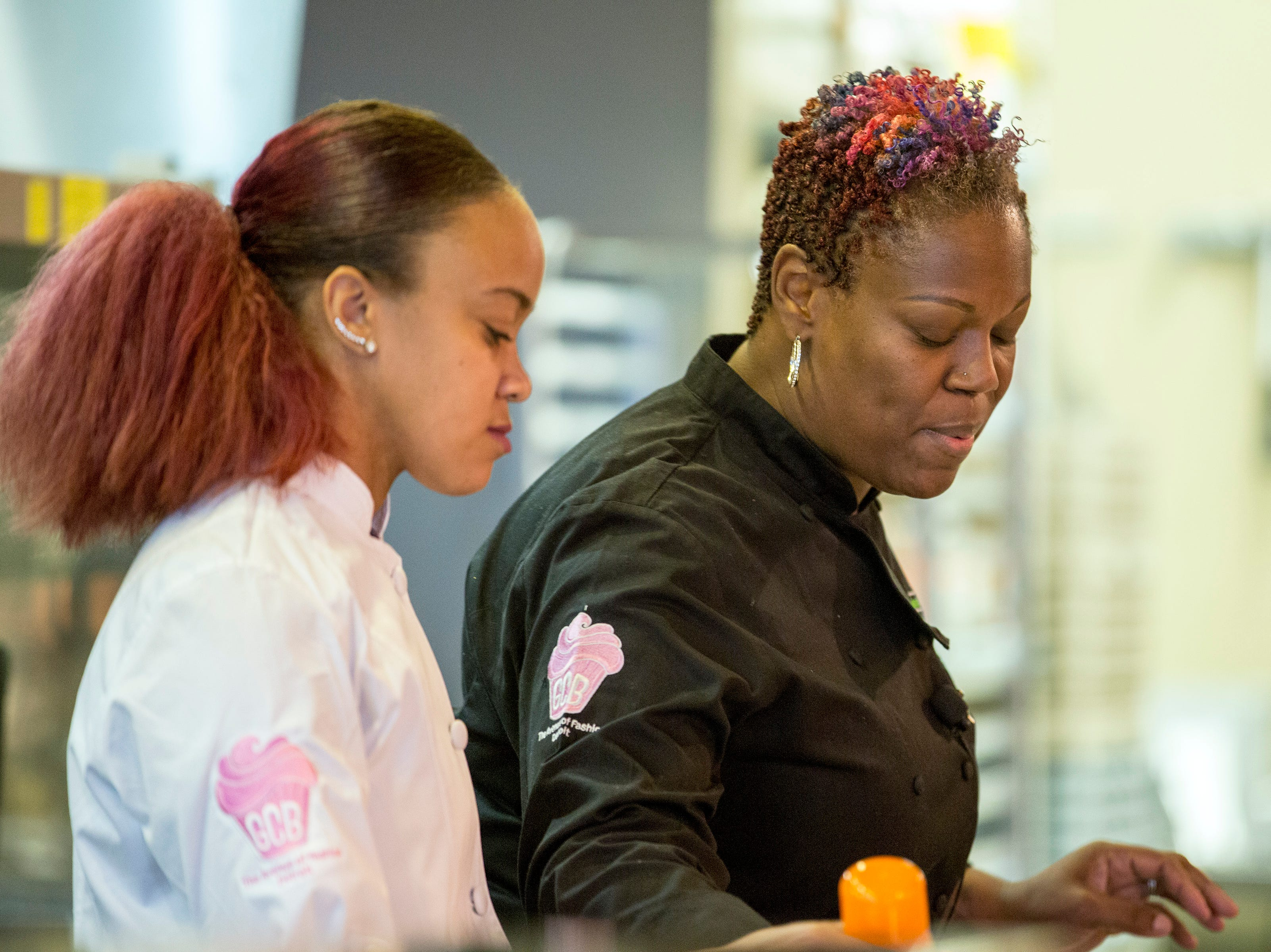 From left, Tanea Blanchard and April Anderson of Good Cakes and Bakes do a live cooking demonstration during the sold-out Whisked event at the Great Lakes Culinary Center in Southfield, Mich., Sunday, Nov. 18, 2018.