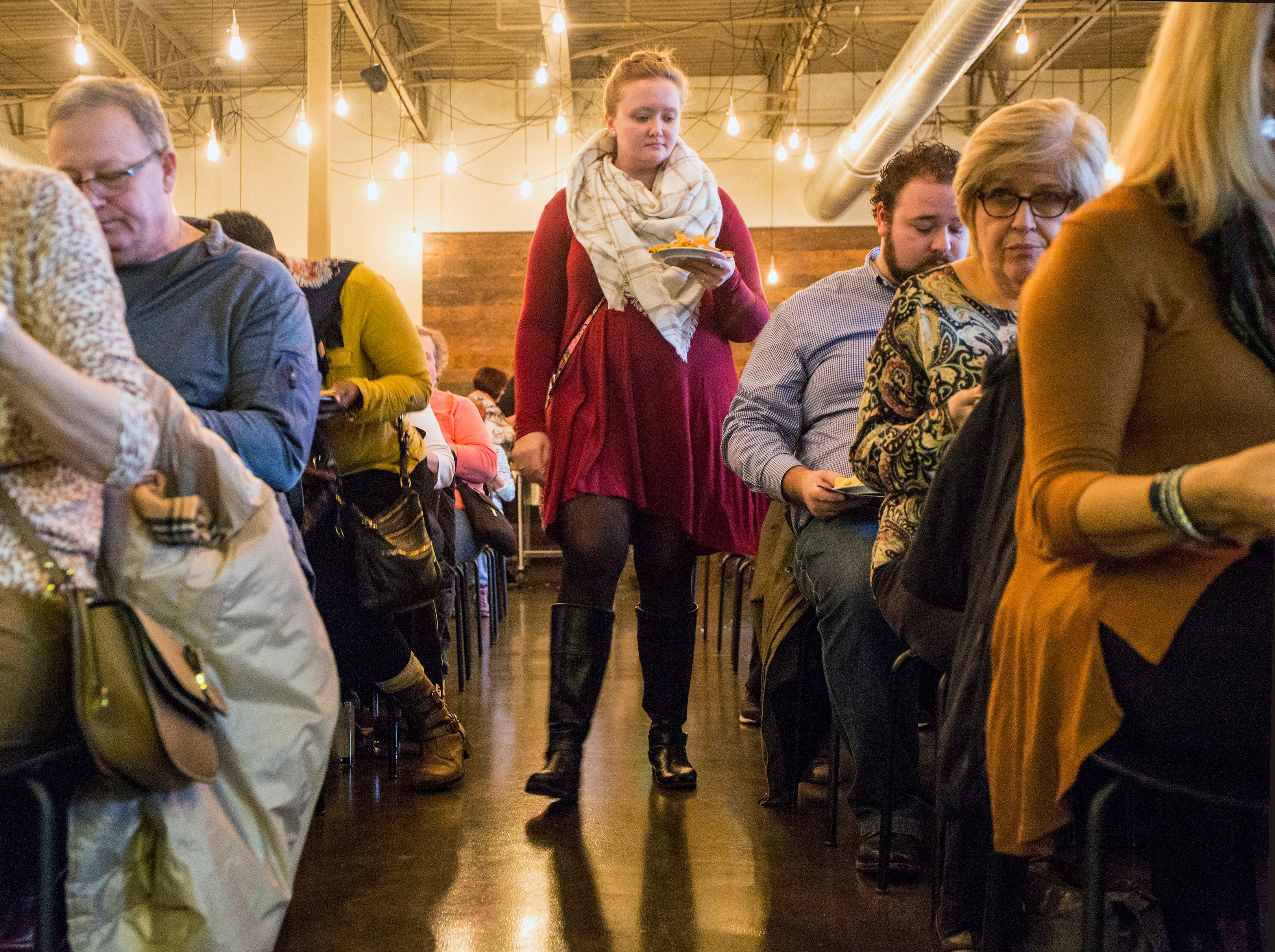 Laura Badarak, 27 of Allen Park makes her way to her seat for the Whisked event cooking demonstrations at the Great Lakes Culinary Center in Southfield, Mich.,Sunday, Nov. 18, 2018.