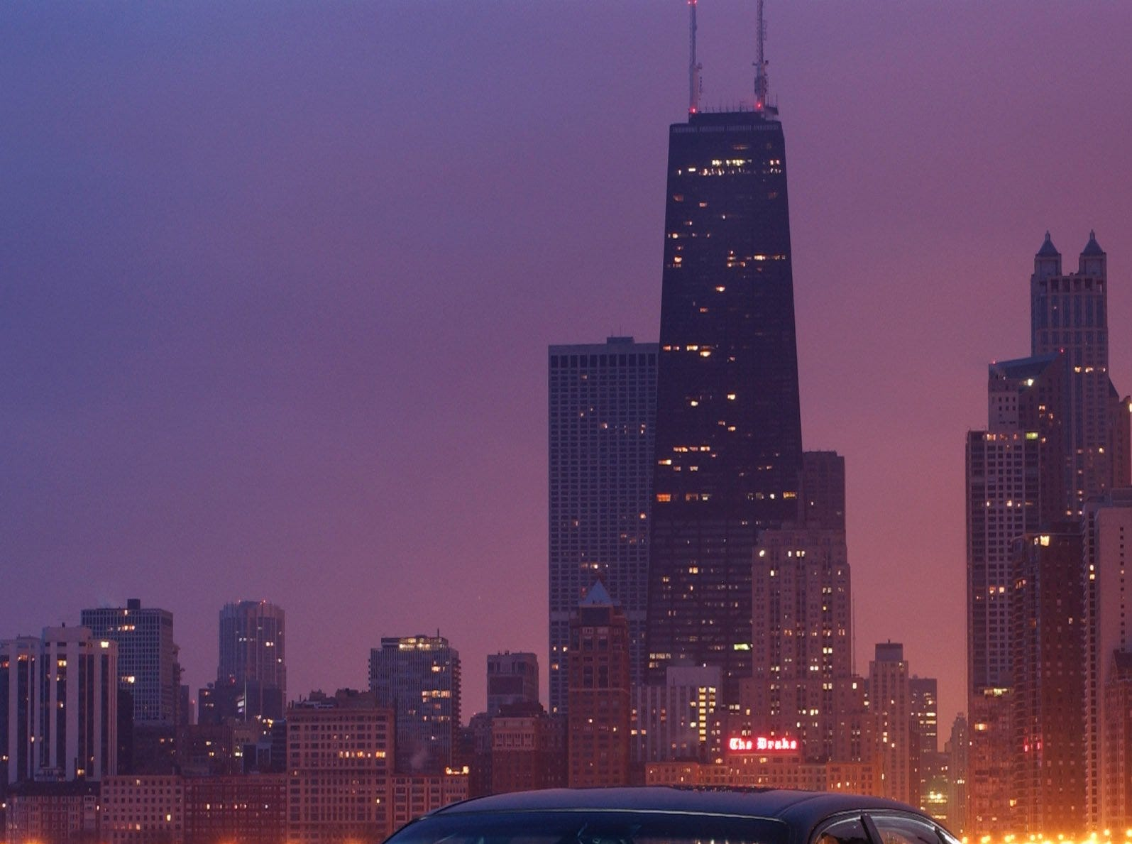 Day breaks over Chicago and the brand new 2004 Chevy Impala SS, which will make its world debut at the Chicago Auto Show Wednesday, Feb. 12 2003.