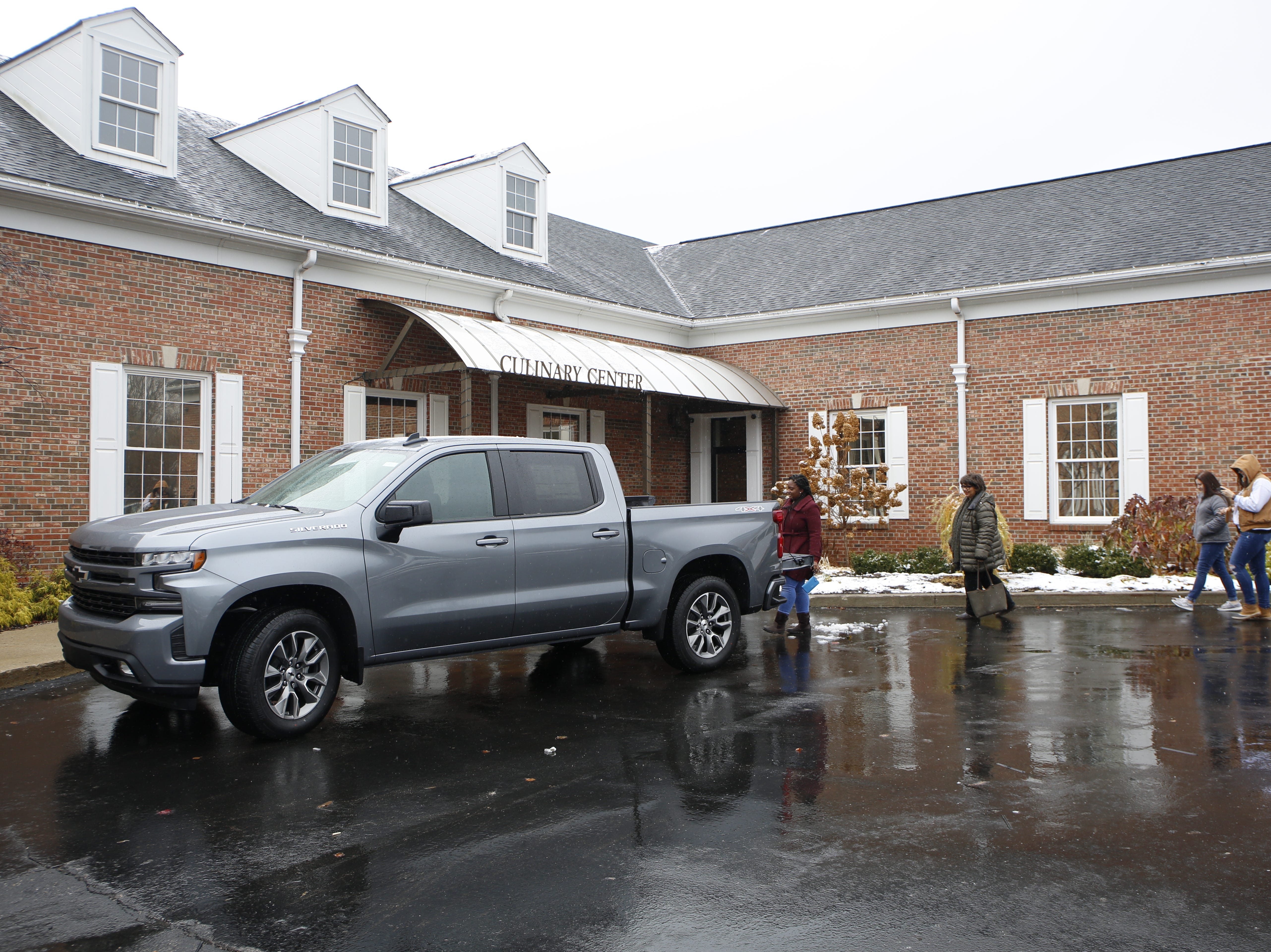 Guests arrive to the Whisked event sponsored by the Metro Detroit Chevy Dealers dropping off food donations for Forgotten Harvest into the bed of a Chevy Silverado at the Great Lakes Culinary Center in Southfield, Mich., Sunday, Nov. 18, 2018.
