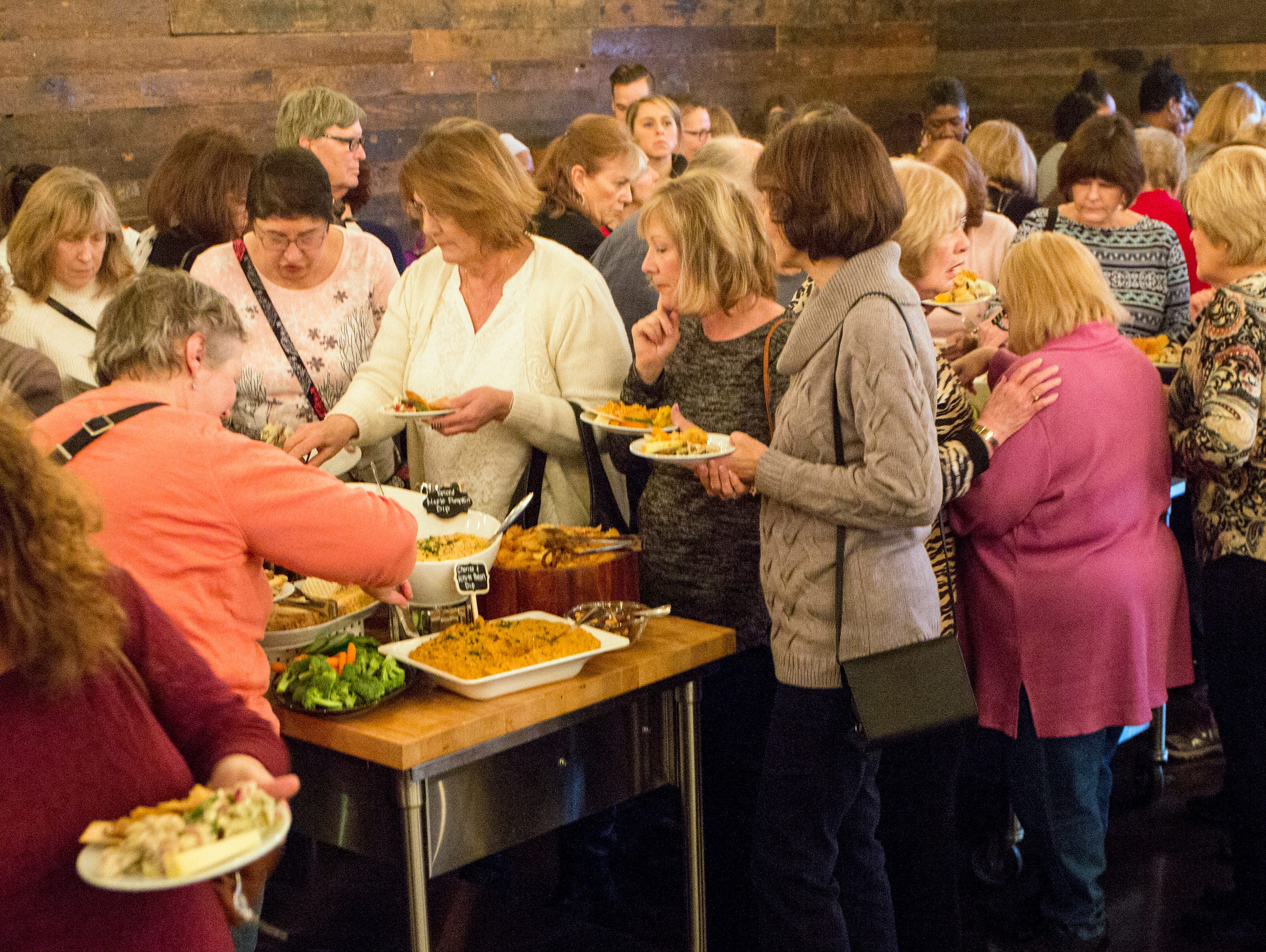 The sold-out crowd enjoys appetizers before the live cooking demonstrations during the Whisked event at the Great Lakes Culinary Center in Southfield, Mich., Sunday, Nov. 18, 2018.